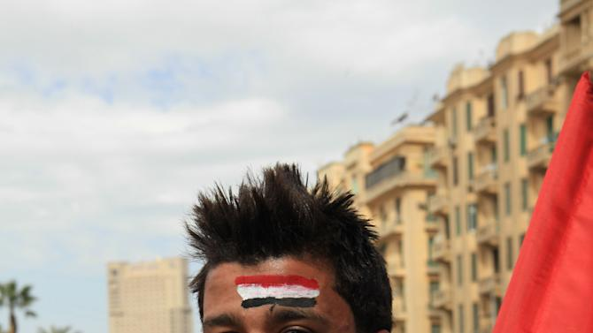 An Egyptian protester displays the national colors in Tahrir Square, Cairo, Egypt, Friday, Jan. 25, 2013. Egyptian opposition protesters are gathering in Cairo's Tahrir Square to mark the second anniversary of the uprising that toppled Hosni Mubarak's autocratic regime. (AP Photo/Thomas Hartwell)