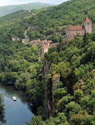 File photo shows the village of Saint-Cirq-Lapopie, perched on a rocky outcrop overlooking the Lot River in southwestern France. Some fear the town, located about 30km east of Cahors, may lose the mediaeval character that has made it such an attraction, but local officials and residents say the tourists are more than welcome
