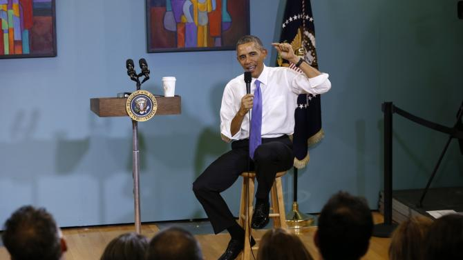 U.S. President Barack Obama speaks about immigration reforms during a visit to Casa Azafran in Nashville