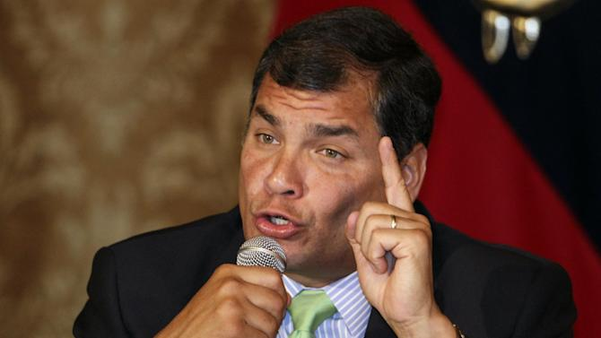 """Ecuador's President Rafael Correa gestures during a press conference in Quito, Ecuador, Wednesday, Dec. 12, 2012.  Correa expressed hope that Venezuela's President Hugo Chavez recovers from his fourth cancer surgery as soon as possible. Correa also said: """"Commander Chavez is very important for Latin America, but if he can't stay at the front of Venezuela, the process of change must continue."""" (AP Photo/Dolores Ochoa)"""