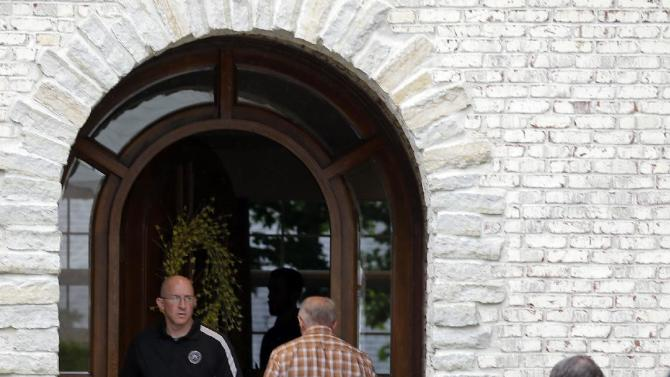 Federal authorities walk outside of  the home of Subway restaurant spokesman Jared Fogle, Tuesday, July 7, 2015, in Zionsville, Ind.  FBI agents and Indiana State Police have removed electronics from the property. FBI Special agent Wendy Osborne said Tuesday that the FBI was conducting an investigation in the Zionsville area but wouldn't confirm it involved Fogle. (AP Photo/Michael Conroy)