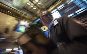 Trader Trader Kenneth Polcari works on the floor of the New York Stock Exchange March 6, 2014. REUTERS/Brendan McDermid