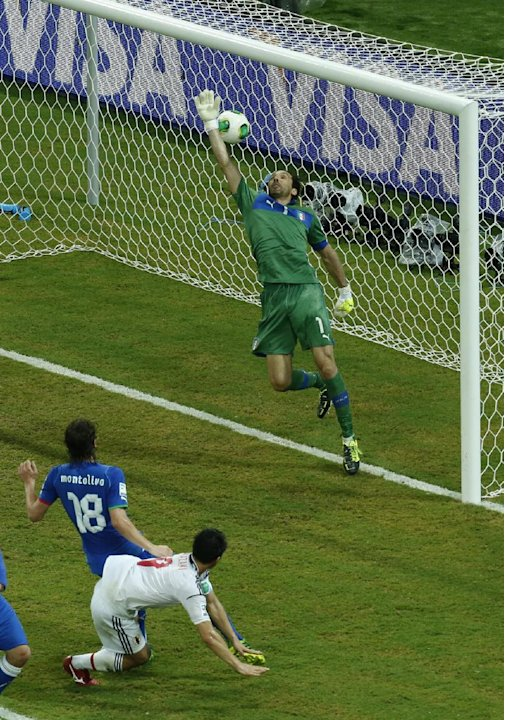 Japan's Shinji Okazaki, bottom, scores his side's 3rd goal past Italy goalkeeper Gianluigi Buffon, top, during the soccer Confederations Cup group A match between Italy and Japan at the Arena Pernambu