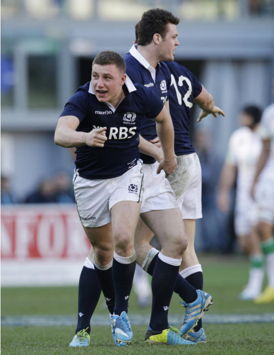 Scotland's Duncan Weir celebrates after he scored the match winning point during a Six Nations rugby union international match between Italy and Scotland, in Rome, Saturday, Feb. 22, 2014. Scotlan