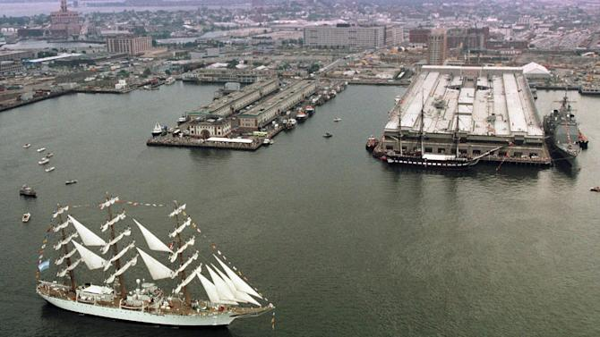 FILE - In this July 23, 1998 file photo, the Argentine frigate Libertad takes part in an international salute to the USS Constitution as it passes in front of Boston Harbor. The flagship of Argentina's navy has been ordered held in Ghana by a judge answering a complaint from a U.S. hedge fund. Ghana ordered the ship held in the first week of Oct. 2012, until Argentina puts up a bond equal to its value, which could be $10 million or more. (AP Photo/Victoria Arocho, File)