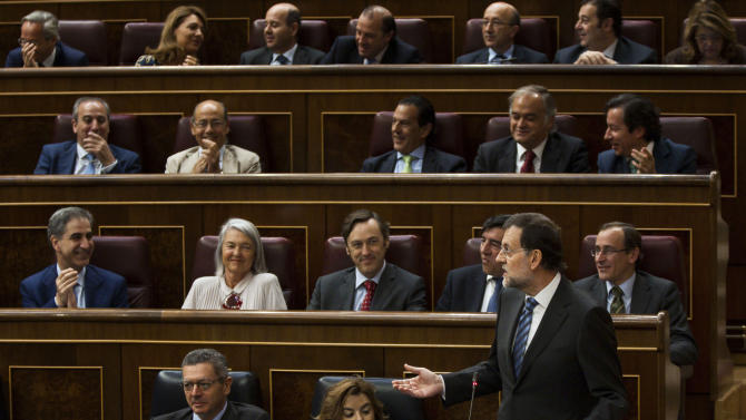 Spain's Prime Minister Mariano Rajoy speaks during a control session at the Spanish Parliament, in Madrid, Wednesday, June 13, 2012. The interest rate Spain would have to pay to raise money on the world's bond markets continued to rise Wednesday amid worries that a planned bank bailout might not be enough to save the country from needing an overall financial rescue. (AP Photo/Daniel Ochoa de Olza)