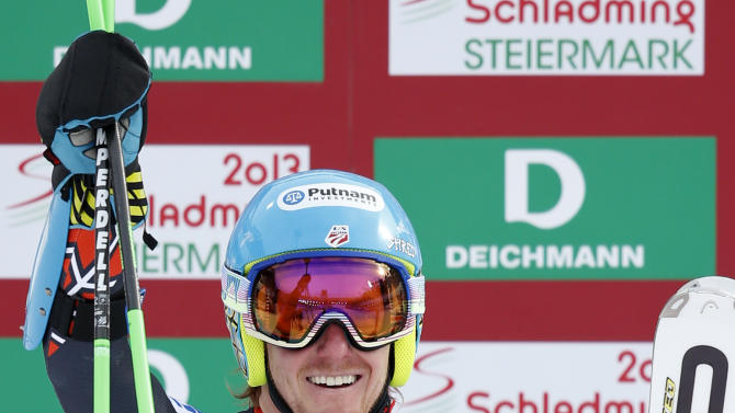 United States's TedLigety celebrates winning the gold medal after the second run of the men's giant slalom at the Alpine skiing world championships in Schladming, Austria, Friday, Feb.15,2013. (AP Photo/Matthias Schrader)