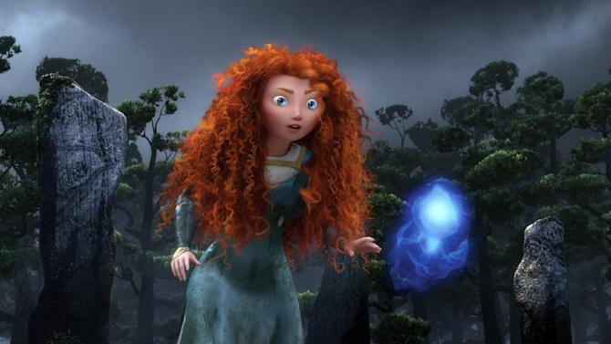 """FILE - In this undated file film image released by Disney/Pixar, the character Merida, voiced by Kelly Macdonald, follows a Wisp in a scene from """"Brave."""" (AP Photo/Disney/Pixar)"""