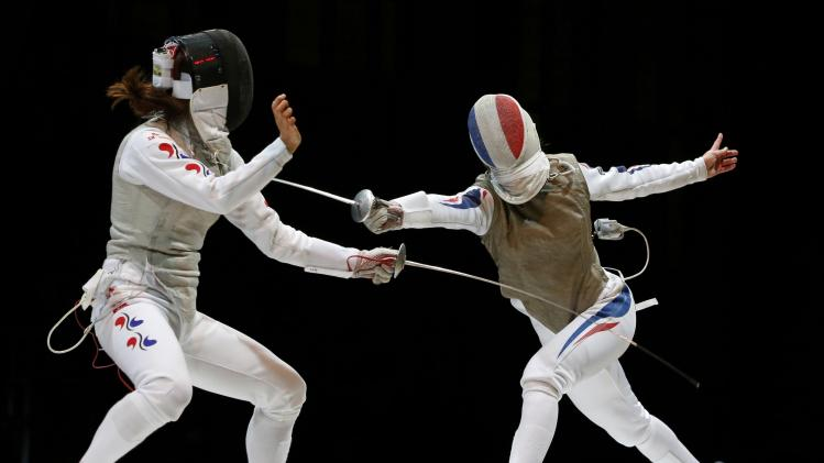 Jeon of South Korea competes against Guyart of France in the women's team foil final match at the World Fencing Championships in Kazan