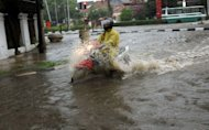 Jokowi Akan Tuntaskan 12 Titik Banjir Tahun Ini
