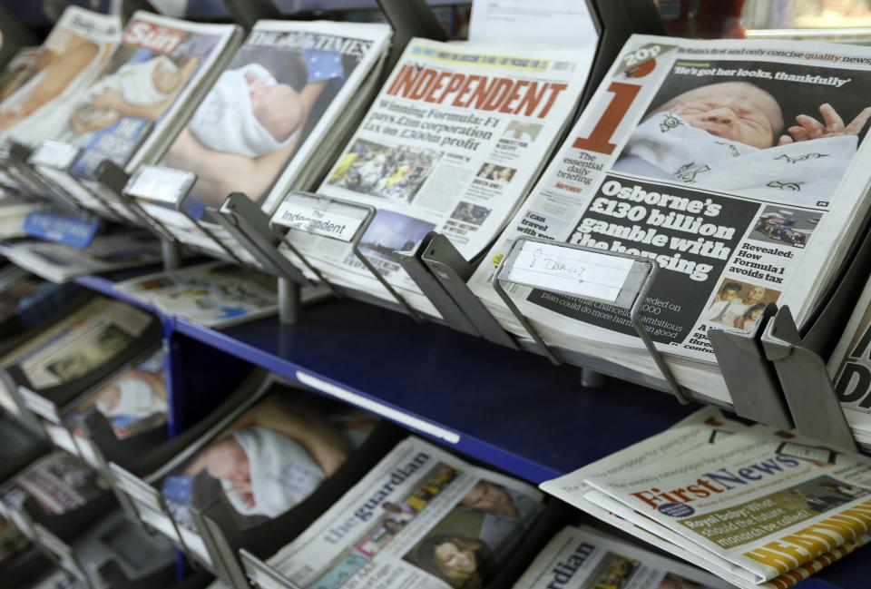 British newspapers are displayed for sale in London, Wednesday, July 24, 2013. The newspapers show coverage of the new royal baby boy, third in line to the throne. (AP Photo/Kirsty Wigglesworth)