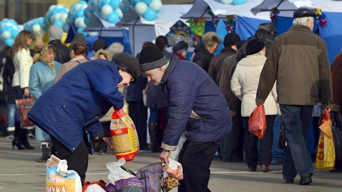 People buy food at a marketpalce in the southern Russian city of Stavropol on December 19, 2014
