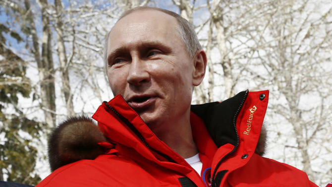 Russian President Vladimir Putin speaks during his meeting with Russian athletes, winners of the cross country 4x2.5km open relay, at the 2014 Winter Paralympic, Saturday, March 15, 2014, in Krasnaya Polyana, Russia. (AP Photo/Dmitry Lovetsky)