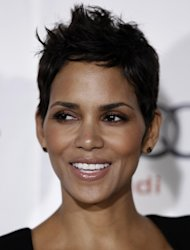 """FILE - In a Nov. 9, 2010 file photo, actress Halle Berry arrives at """"On Acting - A Conversation with Halle Berry"""" during American Film Institute's AFI Fest 2010 in Los Angeles. Berry was taken to a hospital after falling and striking her head on concrete late Tuesday, July 17, 2012, but was later discharged. The 45-year-old Academy Award-winner fell around 10 p.m. Tuesday while shooting a movie and was rushed by ambulance to Cedars-Sinai Medical Center. (AP Photo/Matt Sayles, File)"""