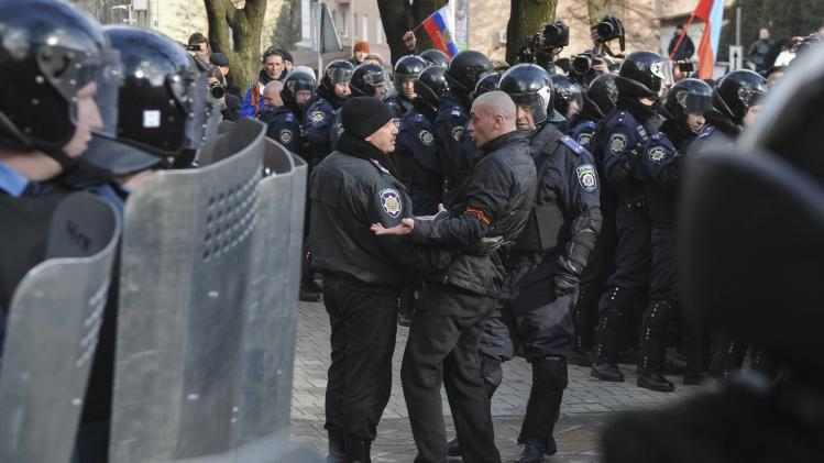 Pro-Russian demonstrator speaks with police during a rally in Donetsk