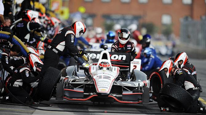 Will Power, of Australia, pits during the IZOD IndyCar Grand Prix of Baltimore auto race, Sunday, Sept. 2, 2012, in Baltimore. (AP Photo/Nick Wass)