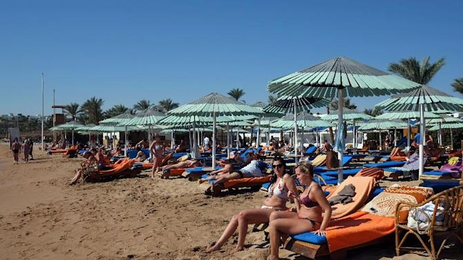 Tourists enjoy the beach in the Egyptian Red Sea resort of Sharm el-Sheikh on February 19, 2014