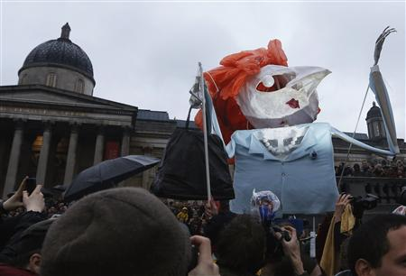 A puppet made to represent the late former British prime minister Margaret Thatcher is carried through the crowd at a party in Trafalgar Square to celebrate her death in central London April 13, 2013. REUTERS/Olivia Harris