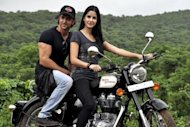 Indian Bollywood personalities Katrina Kaif (R) and Hrithik Roshan pose on a Royal Enfield motorcycle during a promotional event for the film &quot;Zindagi Na Milegi Dobara&quot; in 2011. The road trip drama swept the top honours, including best picture and best director, at the &quot;Bollywood Oscars&quot; held late Saturday in Singapore