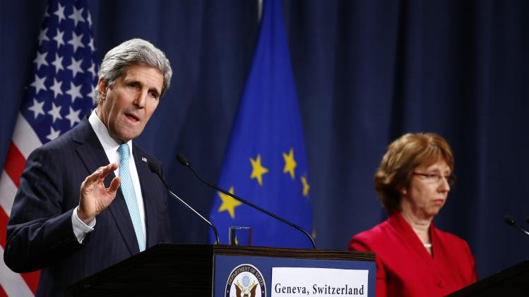 Kerry speaks next to Ashton after talks on the situation in Ukraine, in Geneva