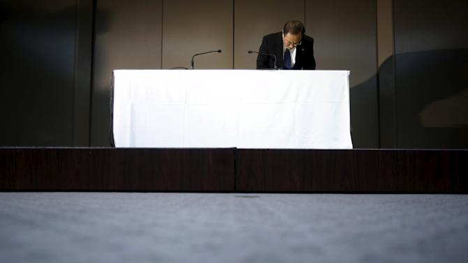 Toshiba Corp President and CEO Muromachi bows to reporters at the beginning of a news conference at the company headquarters in Tokyo