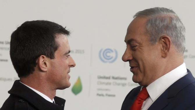 French Prime Minister Valls welcomes Israel's Prime Minister Netanyahu as he arrives for the opening day of the World Climate Change Conference 2015 (COP21) at Le Bourget