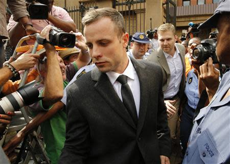 Olympic and Paralympic track star Oscar Pistorius leaves court in Pretoria