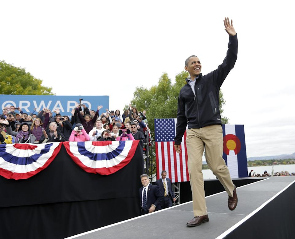 President Barack Obama walks on stage during a campaign event at Sloan's Lake Park, Thursday, Oct. 4, 2012, in Denver. (AP Photo/Pablo Martinez Monsivais)