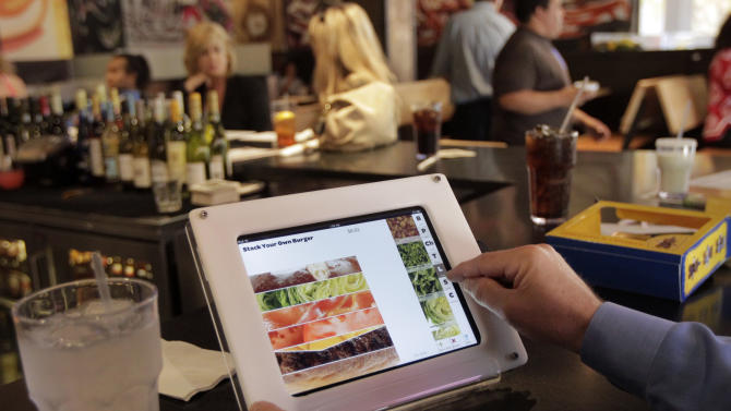 Matt Steiger, of Hermosa Beach, Calif., orders his lunch using an iPad at Stacked restaurant in Torrance, Calif., Tuesday, May 31, 2011. Each table is equipped with an iPad for customers to order their food at the restaurant. (AP Photo/Jae C. Hong)