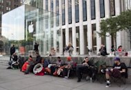 Customers hoping to buy the new iPhone 5 line up outside the Apple store on Fifth Avenue in New York on September 17. Apple received more than two million orders for its new iPhone 5 in just 24 hours, the company said, pushing back many deliveries into October because of unprecedented demand