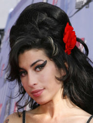 FILE in this June 3, 2007, file photo British singer Amy Winehouse arrives at the MTV Movie Awards in Los Angeles. The family of Amy Winehouse has put the late singer&#39;s London home up for sale for 2.7 million pounds ($4.2 million).The three-bedroom property in the Camden neighborhood of northwest London had become a shrine of sorts for mourning fans who left flowers and tributes following Winehouse&#39;s death last July from alcohol poisoning. A spokesman for the Winehouse family, said Thursday May 31, 2012 that the singer had loved the house and her family put it on the market because they felt it would be inappropriate for any of them to live there. (AP Photo/Kevork Djansezian, File)