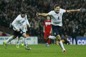 England captain Steven Gerrard celebrates his goal during their 2014 World Cup qualifying soccer match against Poland at Wembley Stadium in London