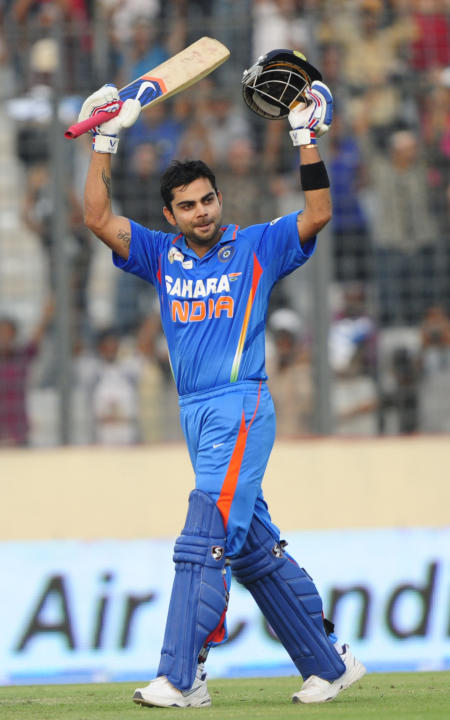 Indian batsman Virat Kohli reacts after