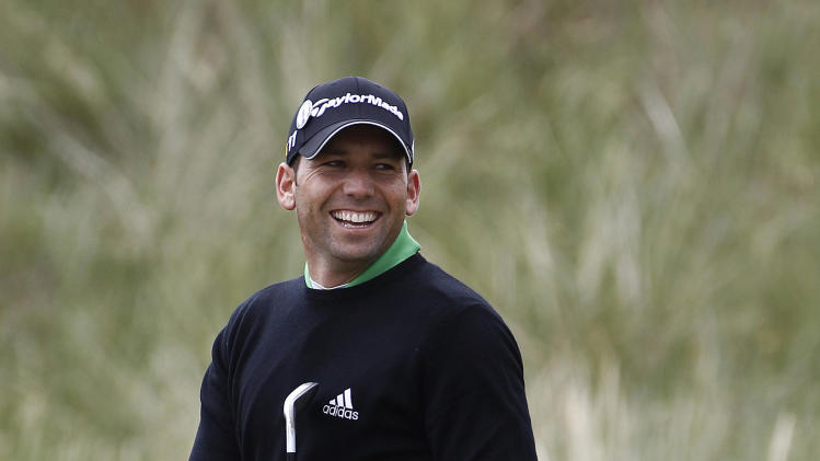 Spain's Sergio Garcia smiles on the 2nd green during a practice round ahead of the British Open Golf Championship at Royal St George's golf course in Sandwich, England, Wednesday, July 13, 2011. (AP Photo/Jon Super)