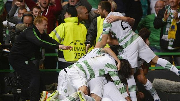 Celtic's manager Neil Lennon (L) joins in the celebrations of the winning goal against Shakhter Karagandy during their Champions League play-off round second leg soccer match at Celtic Park Stadium in Glasgow, Scotland August 28, 2013. (Reuters)