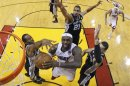 Miami Heat's James goes to the basket past Spurs Duncan, Green and Leonard during Game 6 of the NBA Finals in Miami