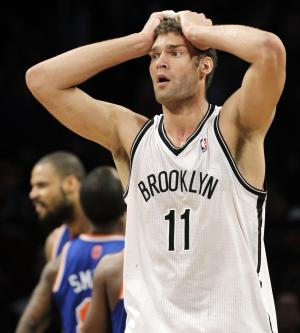 Brooklyn Nets' Brook Lopez reacts after causing an offensive foul in the second half of their NBA basketball game against the New York Knicks at Barclays Center, Monday, Nov. 26, 2012, in New York. The Nets won 96-89 in overtime. (AP Photo/Kathy Willens)