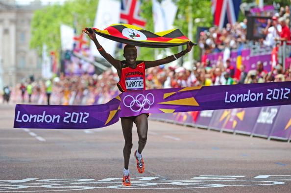 Stephen Kiprotich of Uganda celebrates as he approaches the line to win gold in the Men's Marathon on Day 16 of the London 2012 Olympic Games at The Mall on August 12, 2012 in London, England. (Photo