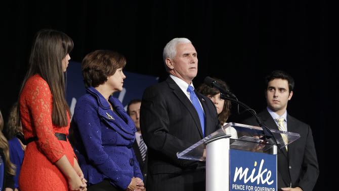 Indiana Republican gubernatorial candidate Mike Pence speaks to supporters with his family at his side at an Indiana Republican Party Tuesday, Nov. 6, 2012, in Indianapolis. Pence defeated  Democrat John Gregg and Libertarian Rupert Boneham. (AP Photo/Darron Cummings)
