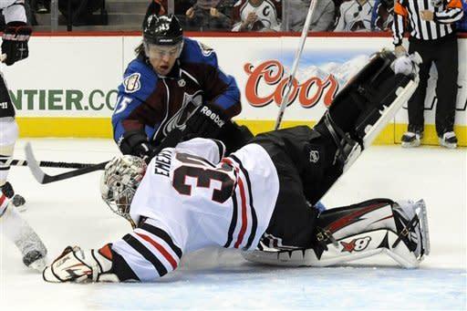 Emery, Kane lead Blackhawks to 5-2 win over Avs