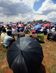 <p>Striking miners stage a protest on the hill at the AngloGold Ashanti mine in Carletonville, 84 kms northwest of Johannesburg.</p>