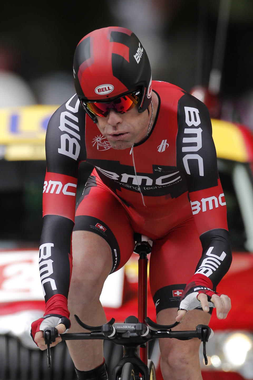 Cadel Evans of Australia blows out air as he crosses the finish line of the prologue of the Tour de France cycling race, an individual time trial over 6,4 kilometers (4 miles) with start and finish in Liege, Belgium, Saturday June 30 2012. (AP Photo/Laurent Rebours)