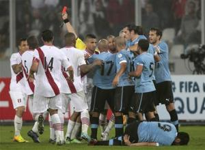 Peru and Uruguay players scuffle after the referee sends off Peru's Yotun with a red card during their 2014 World Cup qualifying soccer match in Lima