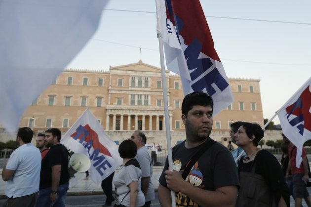 Protesters from communist-affiliated trade union PAME march during a rally against labour reforms in Athens