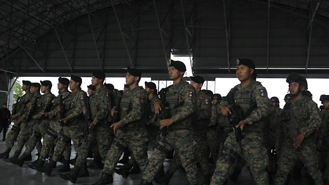 Members of the border police and Special forces Unit walk in formation as they take part in a security exercise at the Panama Pacific airport in Panama City