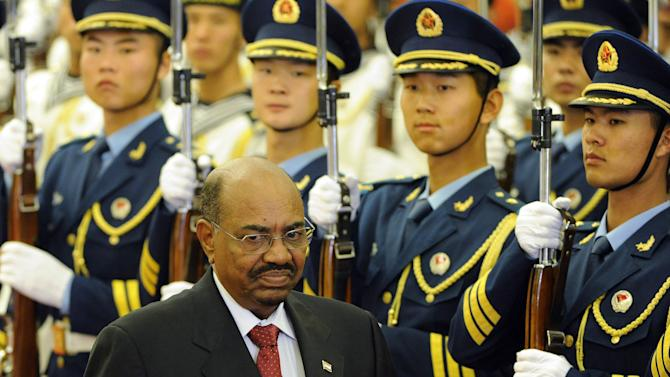 Sudan's President Omar al-Bashir reviews the Chinese military honor guard during a welcoming ceremony at the Great Hall of the People in Beijing, China Wednesday, June 29, 2011. (AP Photo/Liu Jin, Pool)