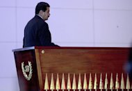 Venezuelan President Nicolas Maduro walks in front the coffin of Liberator Simon Bolivar during the opening of a new mausoleum in his honour, in Caracas on May 14, 2013. Maduro, a former bus driver and union organizer, was a member of Hugo Chavez's inner circle throughout the late leader's reign, serving as his vice president and foreign minister