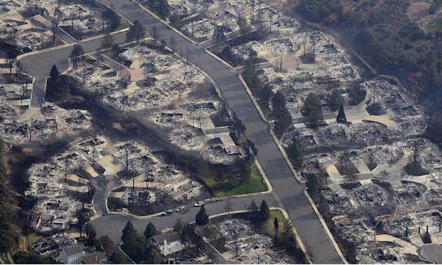 This aerial photo shows the destructive path of the Waldo Canyon fire in the Mountain Shadows subdivision area of Colorado Springs, Colo., Thursday, June 28, 2012. Colorado Springs officials  said Thu