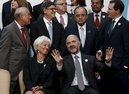 European Economic and Financial Affairs Commissioner Moscovici and IMF Managing Director Lagarde speak as they wait for a group photo of the G20 Finance Ministers and Central Bank Governors in Ankara