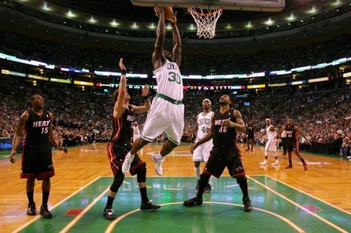 Boston Celtics' Brandon Bass attempts a dunk during the first half of game four